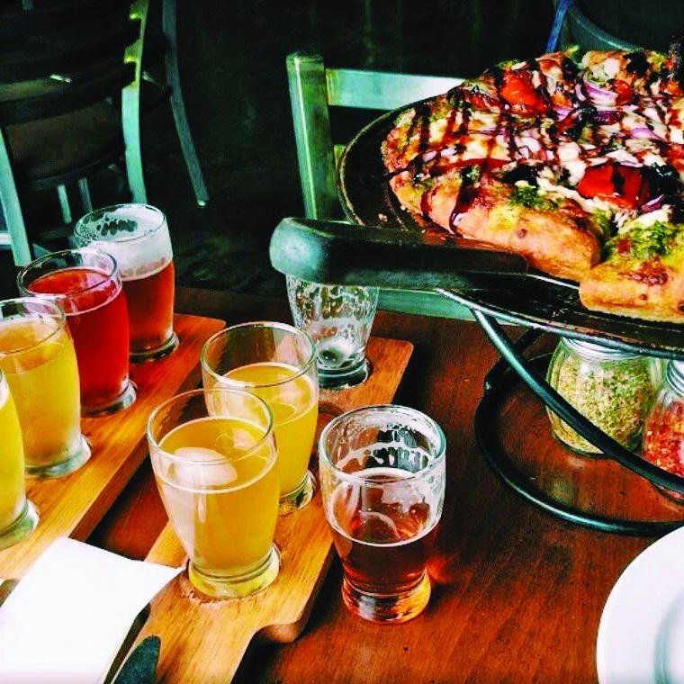 Pizza and beer sampler at Beerhead Bar