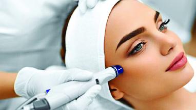 woman receiving a facial at a spa