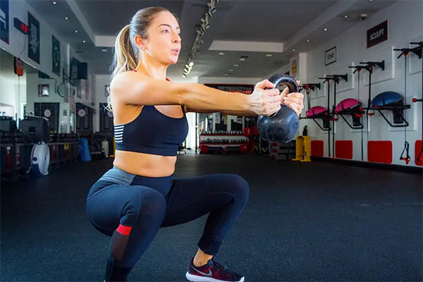 woman doing kettlebell exercises at Better Body Bootcamp