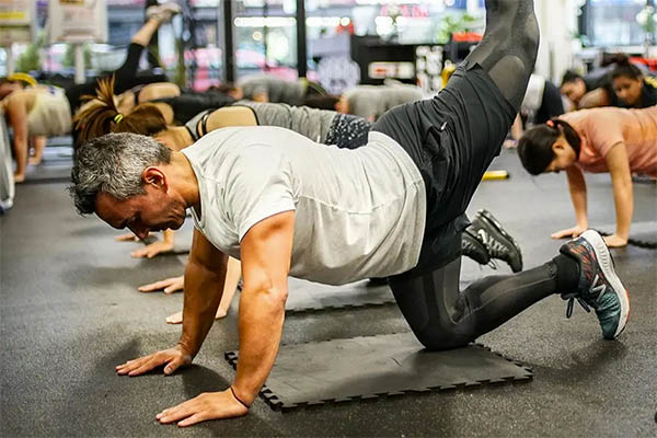 man working out at Better Body Bootcamp Queens NY