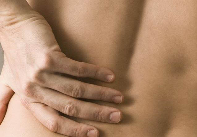 photo of hand rubbing back pain relieved by Better Health Chiropractic & Rehab in Riverview, MI