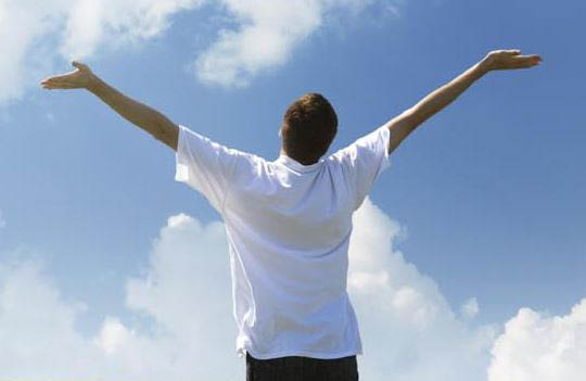 photo of man with arms to sky - free from pain at Better Health Chiro & Rehab in Riverview, MI