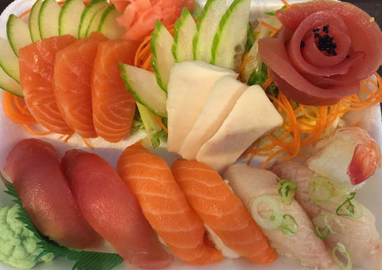Variety of sushi rolls with cooked and raw fish