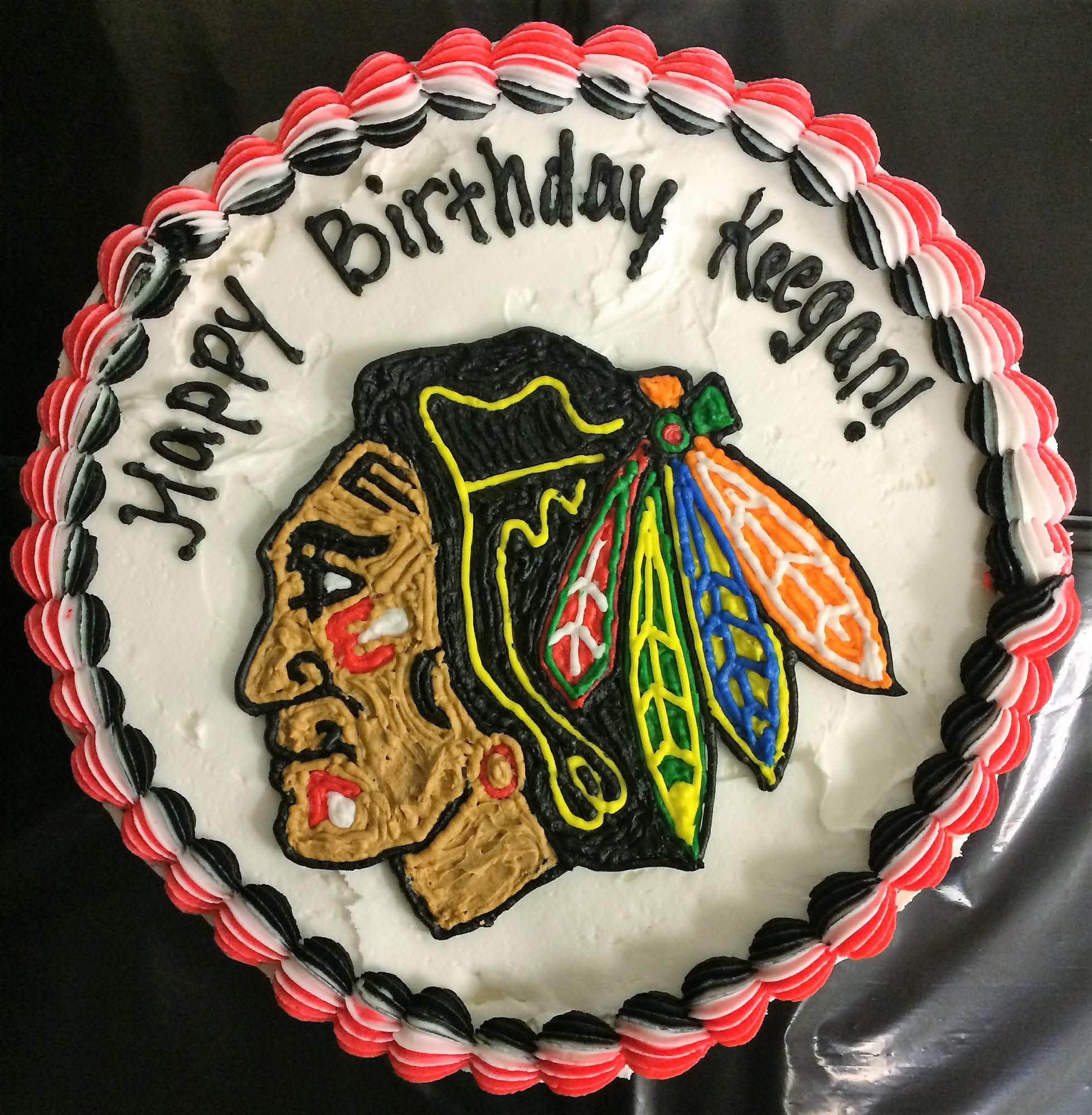 Happy Birthday cake featuring hockey team.