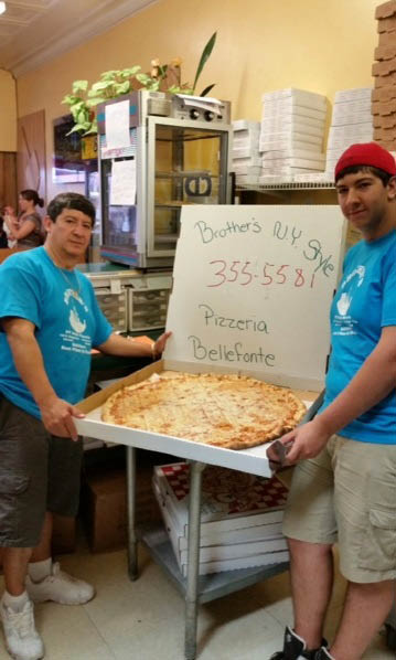 XXL cheese pizza cut into squares near Wingate, PA