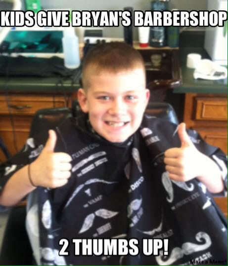 Happy kid after haircut at Bryan's Barbershop