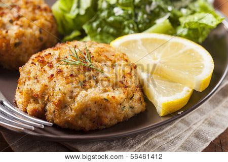 Crab cakes served with cocktail or tartar sauce
