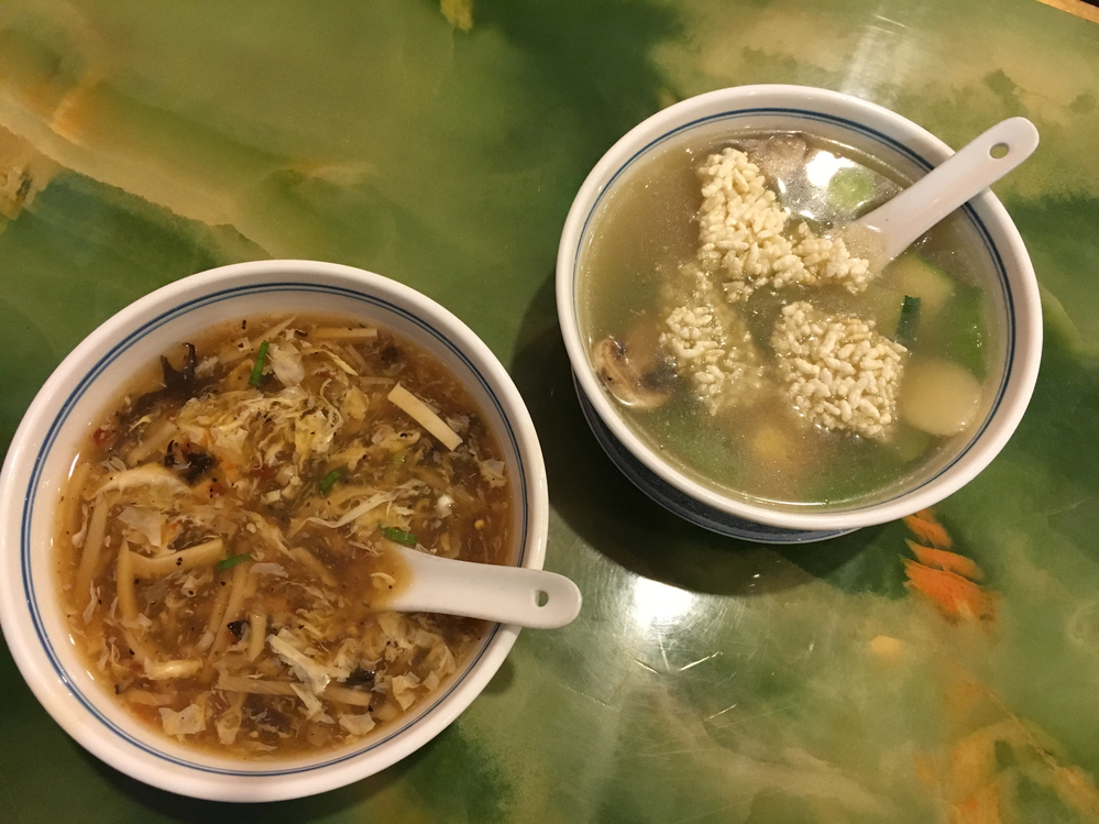 Two bowls of Chinese soups