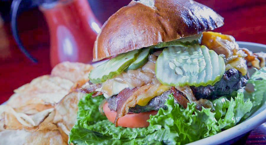 Menu selections include burgers, sandwiches, fajitas, BBQ and our famous salad bar