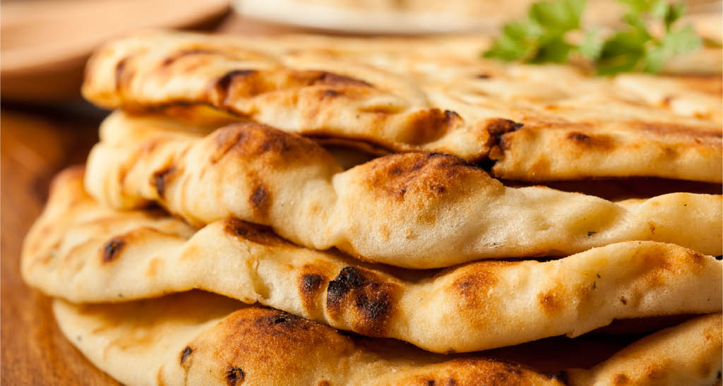 Fresh and homemade Naan bread from Clay Oven Cuisine of India in Woodinville, Washington - Indian food near me - Indian restaurants near me - Indian food coupons near me - Indian restaurant coupons near me