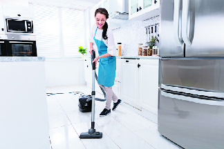 Maid cleaning vinyl flooring