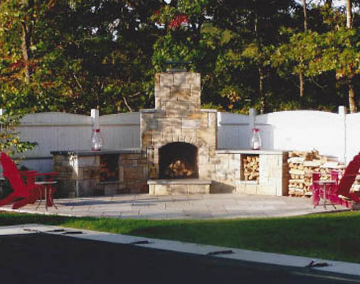 A beautiful outdoor Fireplace can also be built as a cooking area. This is one of many custom outdoor fireplaces that Clover Landscape built for a customer.