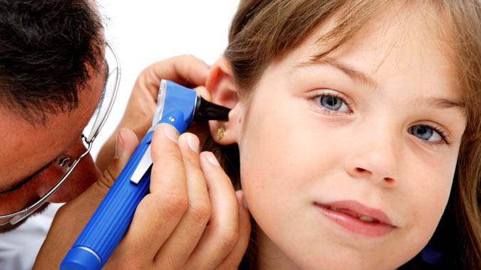 Hearing tests for children - little girl getting her hearing tested - hearing screenings - Coordinated Care health insurance - Seattle, WA