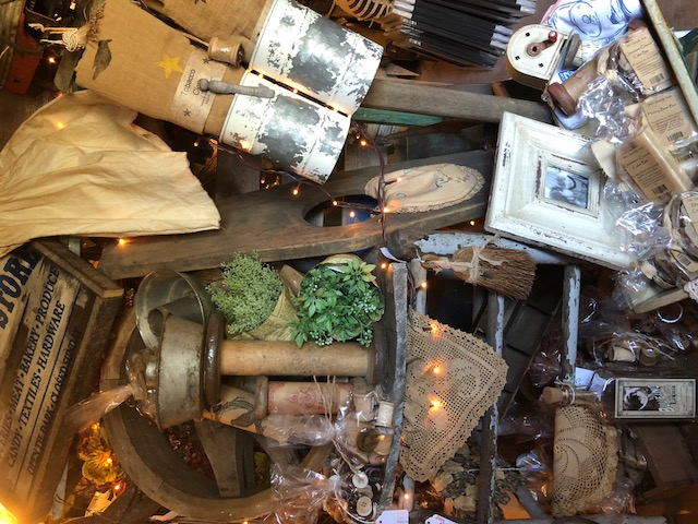 Tin items, lace, frames and old bottles