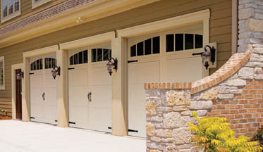 photo of triple garage doors from Crawford Door Company in Lansing, MI
