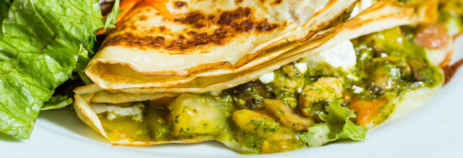 Overstuffed crepe filled with locally-sourced, fresh veggies image