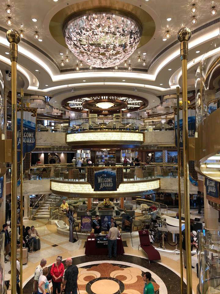 Inside the lobby of a cruise ship - book a cruise today with David McMurrin at Cruise Planners - your land and cruise experts