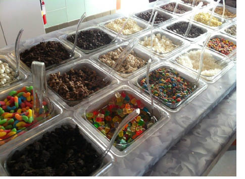 So many toppings topping to chose from at Cups Frozen Yogurt in Parsippny NJ