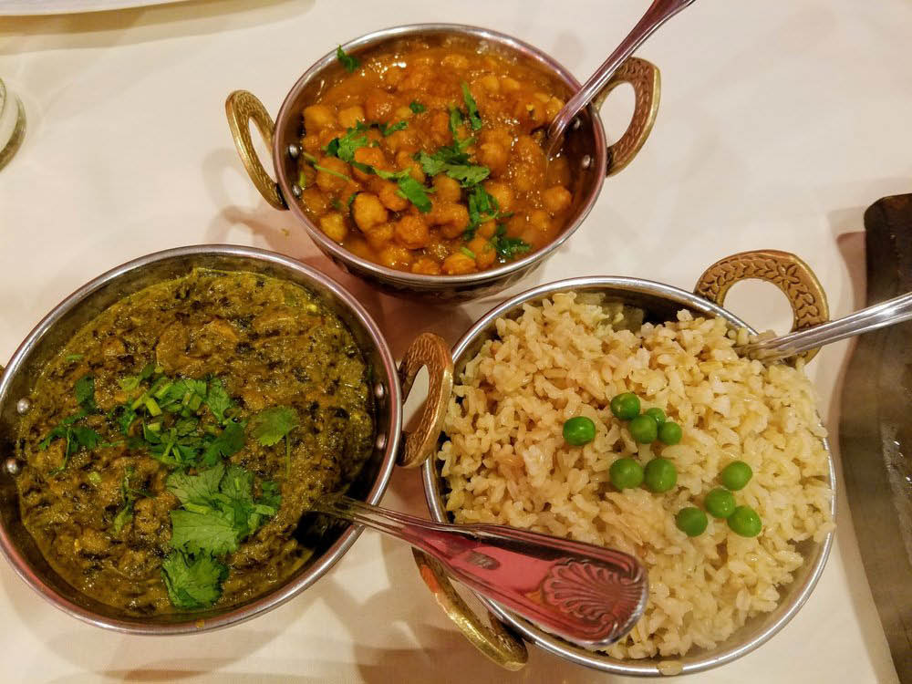 Plated Savory Saag Paneer, Channa Masala and Rice bowls near Rodeo, CA