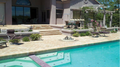 New tiling laid near outdoor pool landscaping with trellis