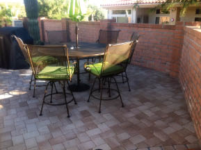 Concrete fence installation with new brick laying near Tucson