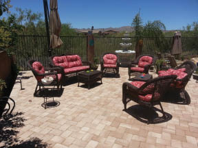 Outdoor stone patio covering with fountain installation near Picture Rocks