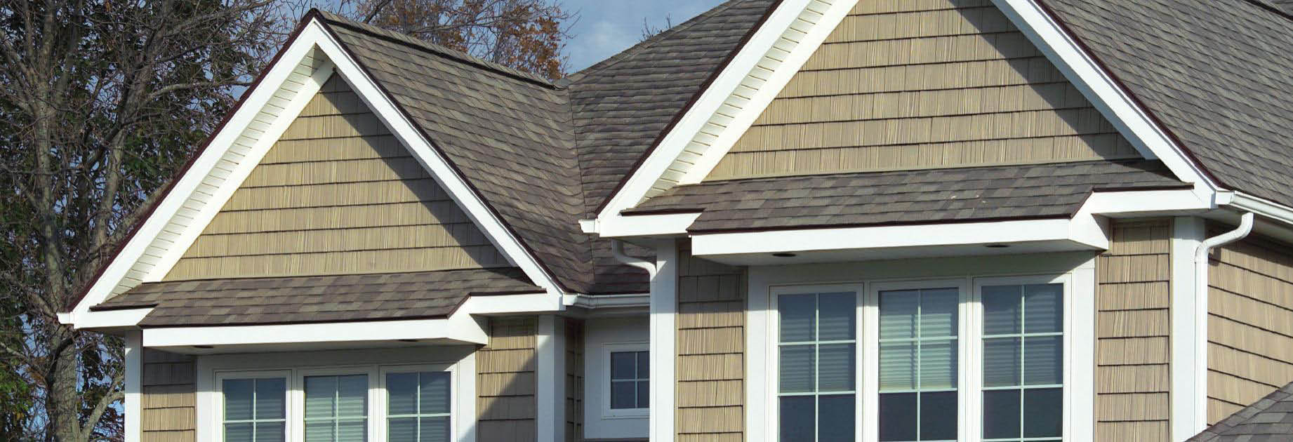 Exterior home showing roofing, siding and shingles banner