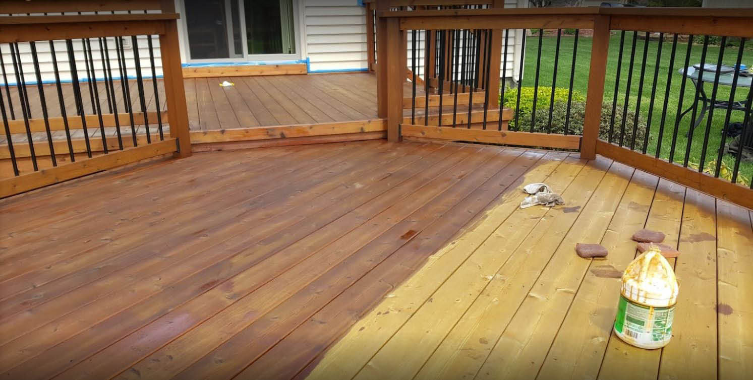 Picture of a deck being stained by Gary's Deck Cleaning in Livonia, MI