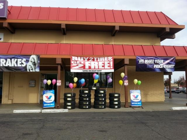 stacks of auto tires outside Discount Tire Centers; tire sale; discount tires
