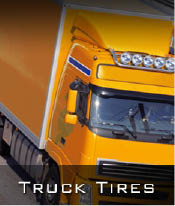 Photo of yellow moving truck featuring truck tires.