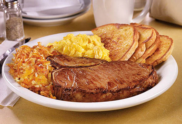 T Bone steak and eggs with grits and potatoes near Baldwin Park