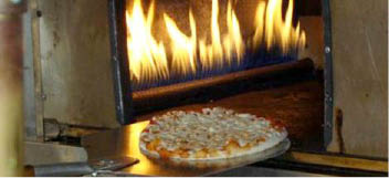 Our 'pizza' is baked in our restaurant oven