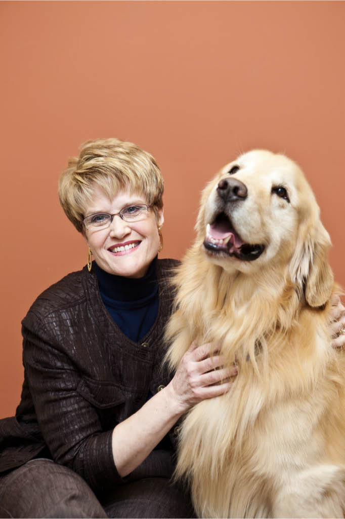 Dr. Jane providing wellcare services to dogs