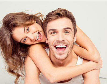 Man and woman with white, healthy teeth