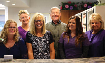 photo of Dr. Terry Potter and dental staff at Mid-Michigan Dental Group