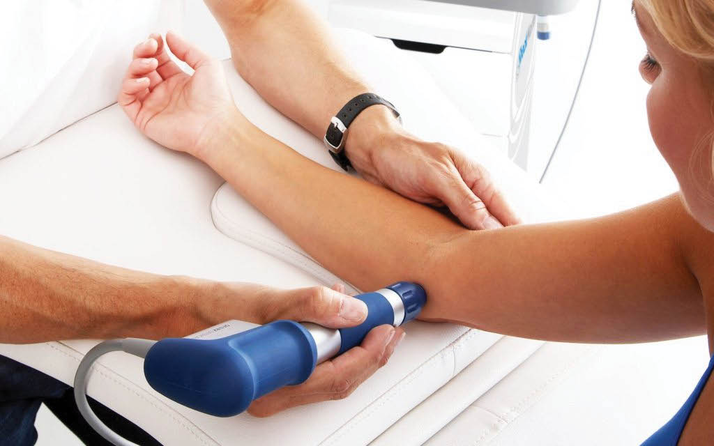 Pressure Wave Therapy performed by Dr. Jeffrey Metcalf at Metcalf Chiropractic Health & Laser Center in Duvall, Washington - relieve joint pain - relieve elbow pain - Duvall chiropractors near me