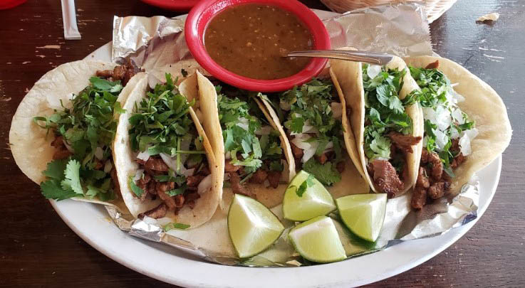 Beefy Mexican fajitas with lime and pico de gallo