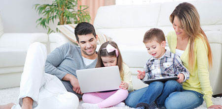 Easy Cooling & Heating - Happy family warm at home with heat from their Mirage ductless mini split heat pump