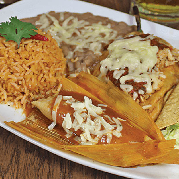 Tamale, enchilada rice and beans combo