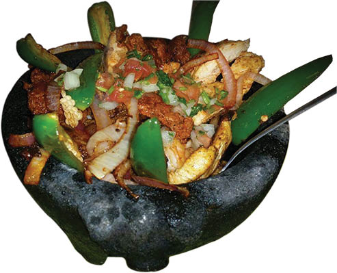 Molcajete Azteca served in a hot stone bowl at El Rodeo. A very unique dish & a favorite for those diners that know authentic Mexican cuisine.