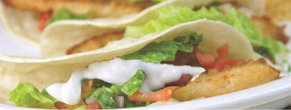 Fresh Mexican fish tacos in flour tortillas