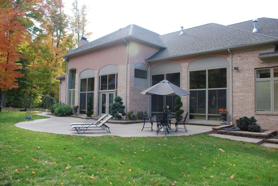 Specialty brick porch enclosure adds value to your home