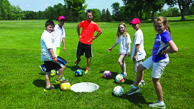 group of people on a foot golf course; soccer golf at Evergreen Golf in Manheim, PA