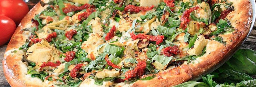 Extreme Pizza in Petaluma whole pizza pie banner