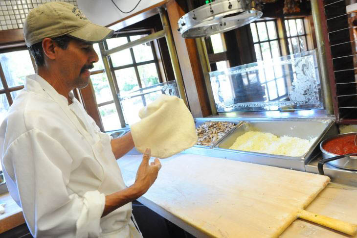 Homemade and hand-tossed pizza dough done the old-fashioned way