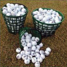 Golf range with buckets of balls to use