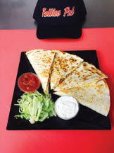 Savor the flavors of our homemade quesadilla with fresh ingredients