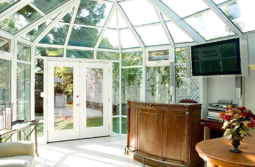 Interior of a gorgeous sunroom installed by Seattle Patio Covers in Federal Way, WA - build my sunroom - sunroom contractors near me - Federal Way home improvement coupons near me