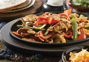 Try our sizzling stir fry with peppers and onions served hot in a cast iron skillet.