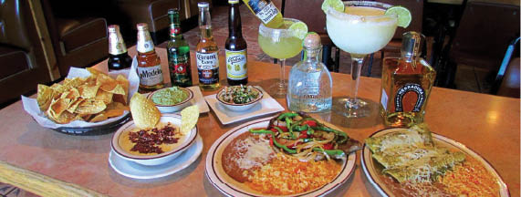 Try a Cerveza, Tequila or Margarita with your queso dip and enchilada.